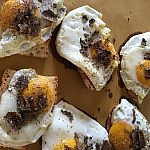 Fried eggs and black truffles