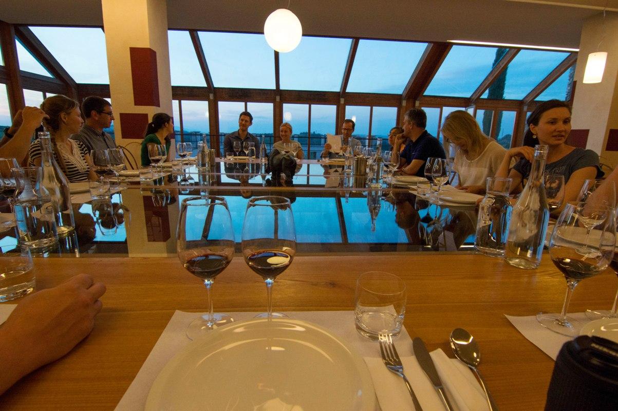 Friends enjoying wine tasting in Tuscany