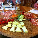 A plate of cheese and cold meats