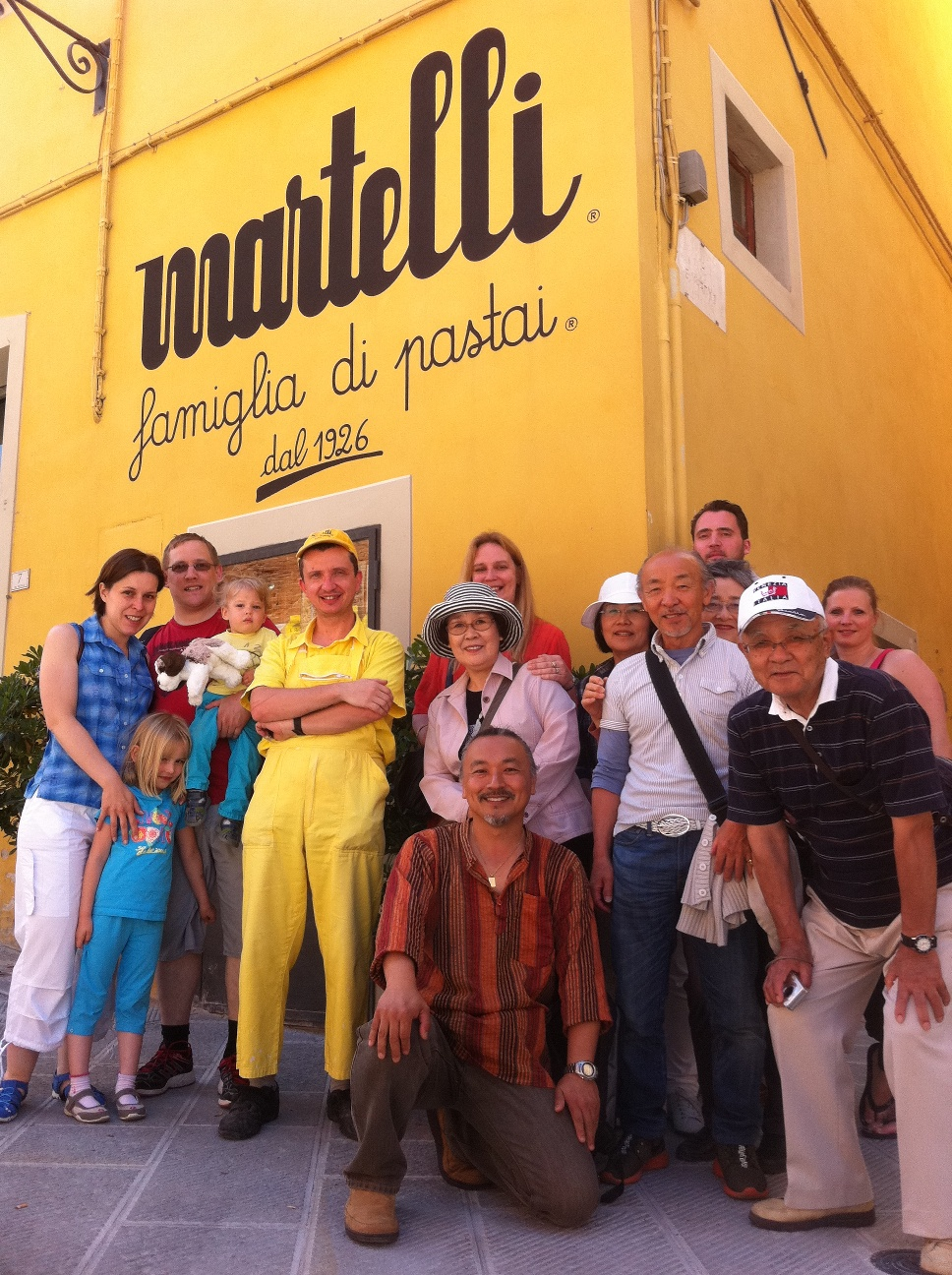 Luca and his guests in front of the pasta factory