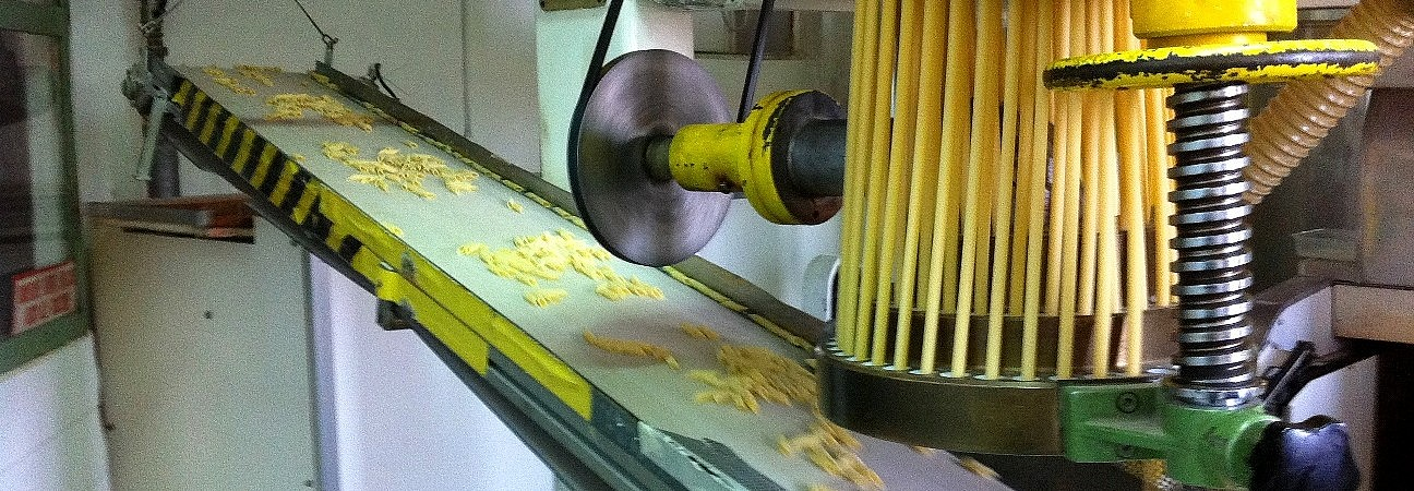 Penne being cut