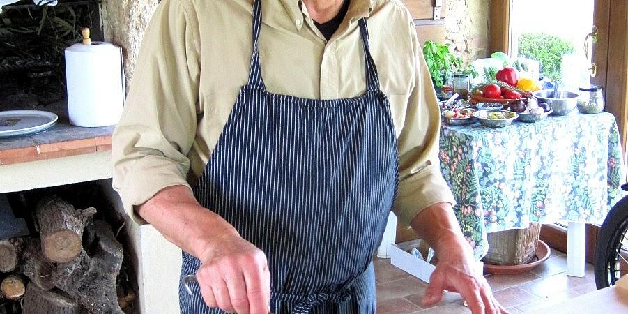 Aldo pouring cecina preparation onto tin