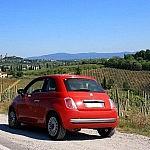 A cinquecento in front of San Gimignano