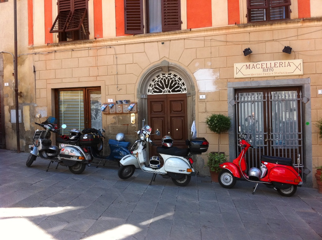 Vespa lined in the central square of Peccioli