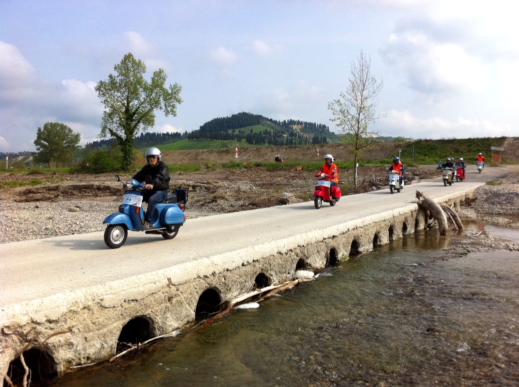 Crossing rivers on vespa scooters