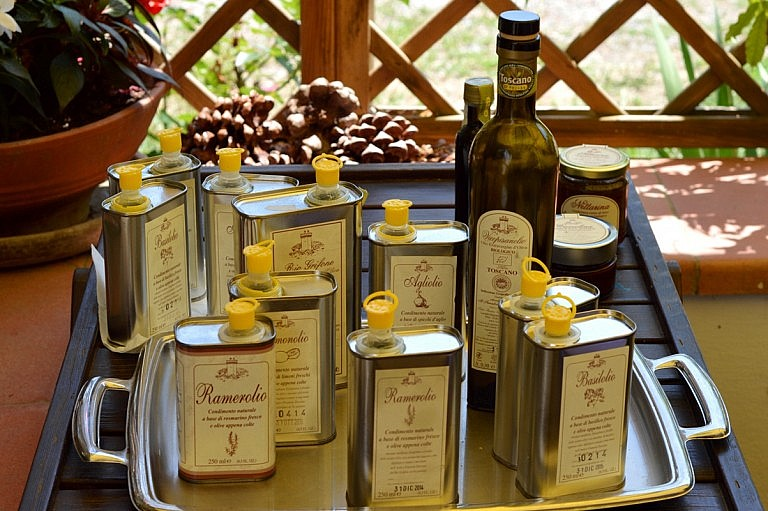 Assorted olive oils with flavors of Tuscan herbs and veggies
