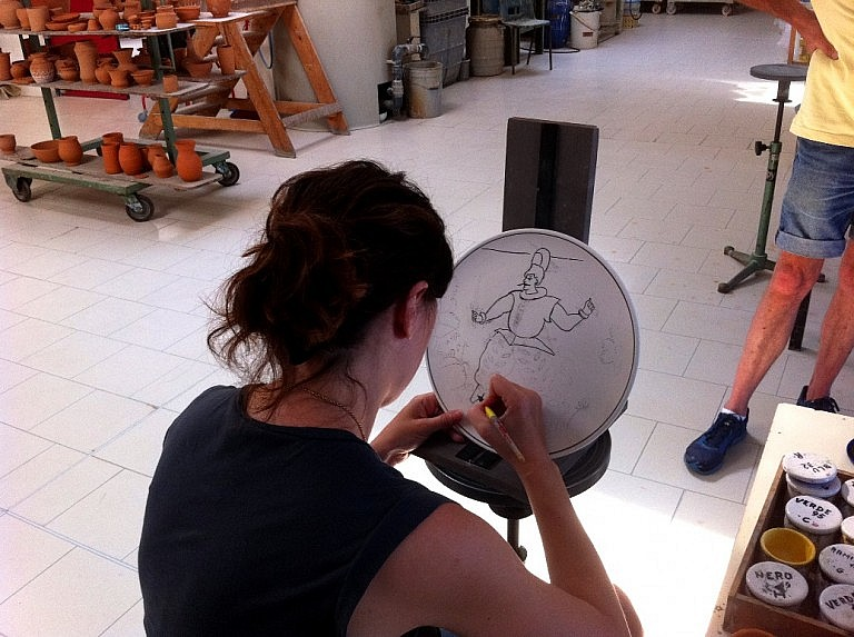 Decorating a ceramic plate near Florence