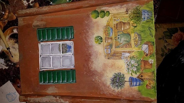 Decoupage decoration on old Tuscan tiles