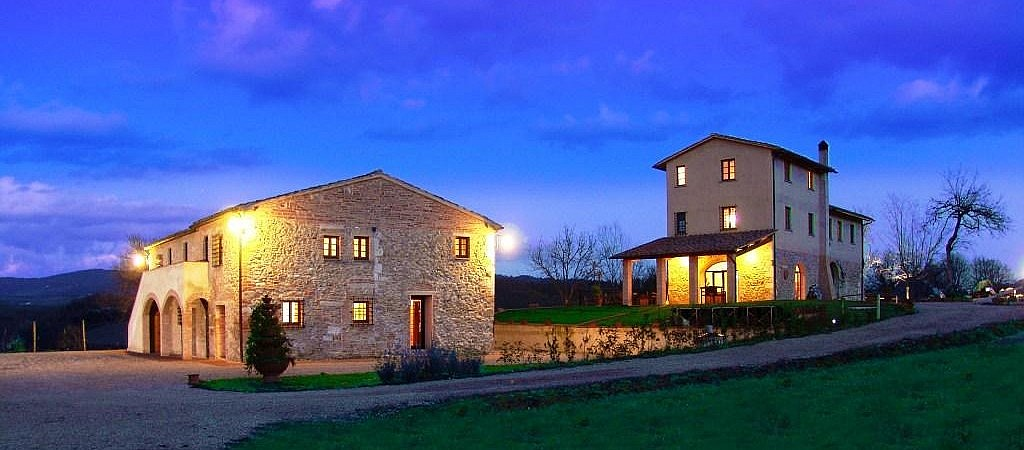 Charming view of an agriturismo in Volterra at sunset