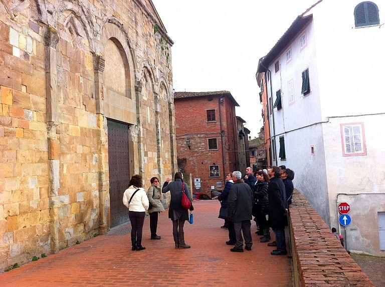 A stop in front of the church of Peccioli