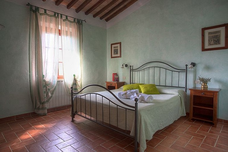 Bedroom in agriturismo with pool in rural Tuscany