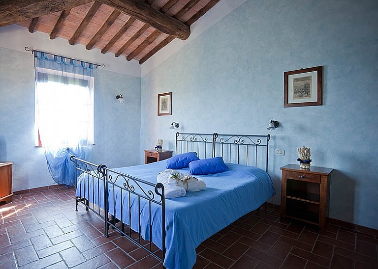Large bedroom with bathroom in Tuscan wine farm