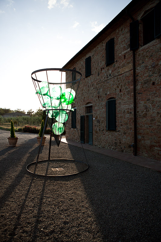 Wine-themed art in Tuscan agriturismo