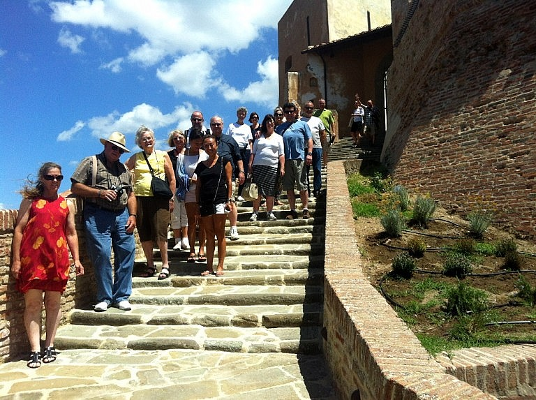 A group of visitors to the castle of Lari