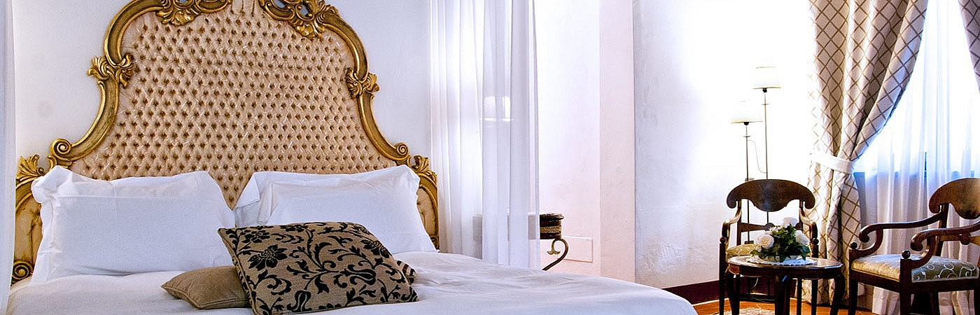 Elegant bedrooms with historical furniture in the small hotel near Pisa