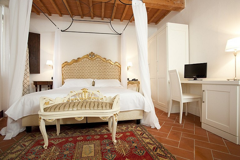 Charming bedroom with tester bed in central Tuscany
