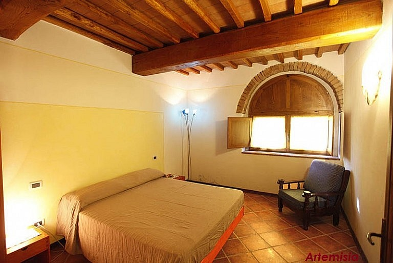 Bedroom in agriturismo in Tuscan rustic style