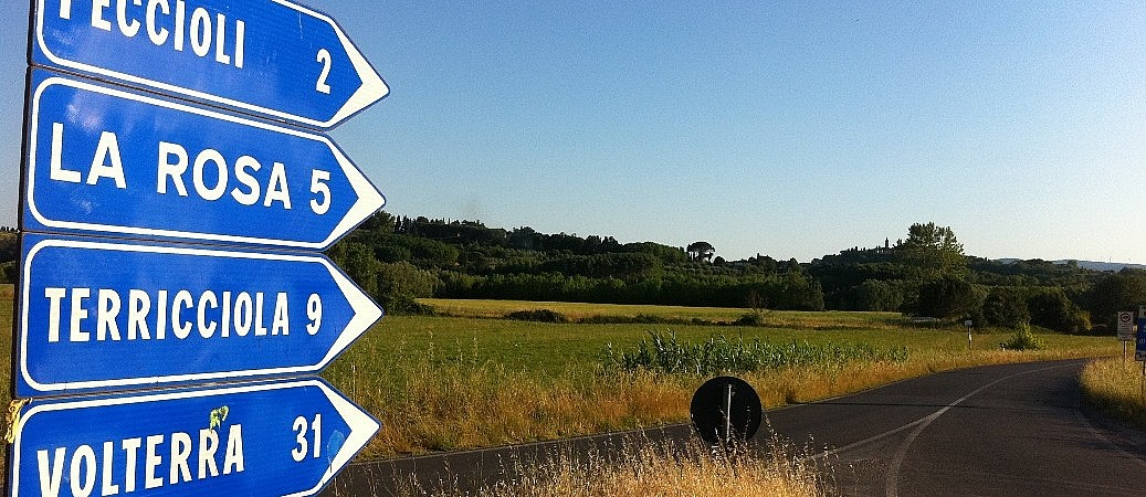 Road signs in the Tuscan countryside