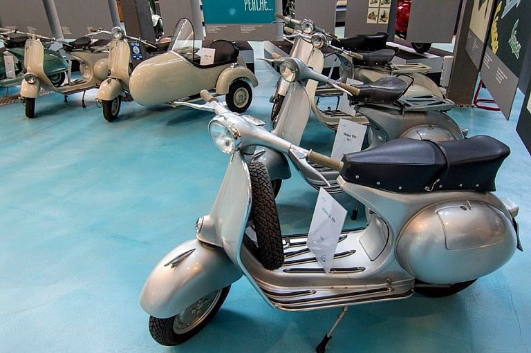 A series of Vespa models from the 50s and 60s
