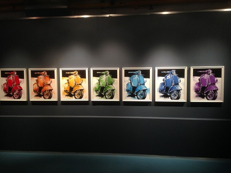 A temporary exhibition of paintings at the Vespa museum