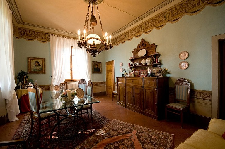 Dining room and sitting room in Tuscan villa