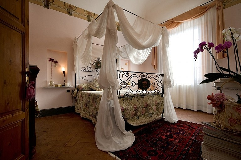 Tester bed in classic bedroom in villa with pool