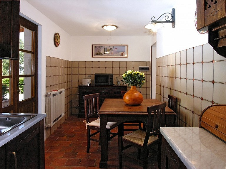 Small kitchen with veranda in cottage
