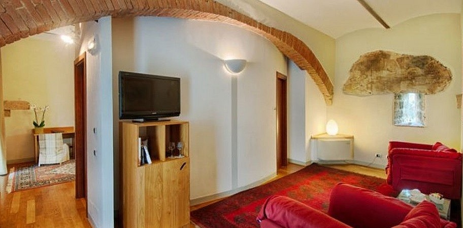 Suite with TV room in boutique hotel