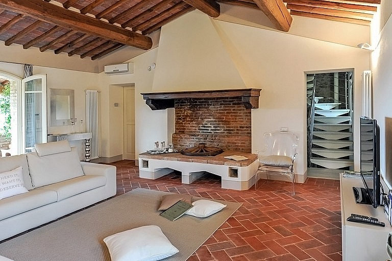 Tuscan large fireplace and refined contemporary sitting room