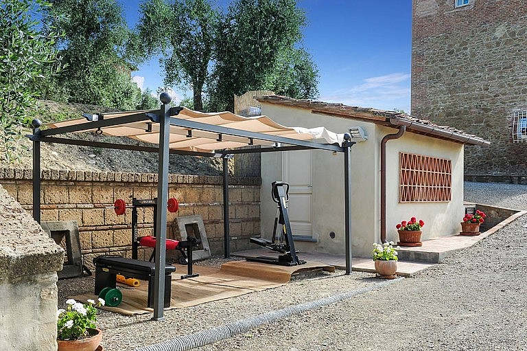 Small private gym by the pool