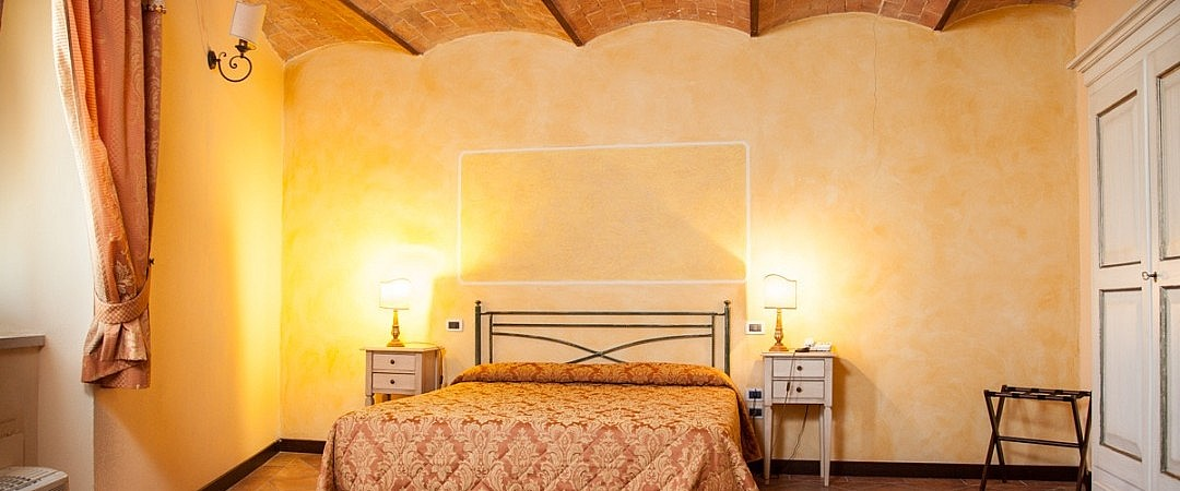 Double bedroom in boutique hotel in Italian spa town