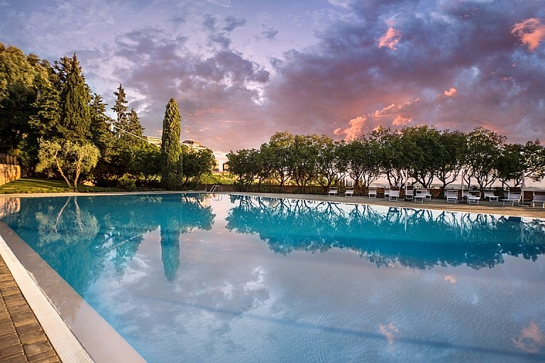 Panoramic pool with view over Tuscan castle