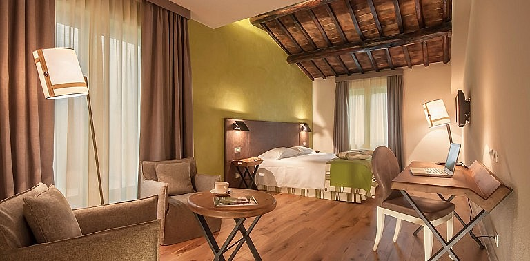 Suite with elegant fittings in boutique hotel of Tuscany