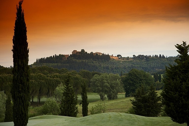 A picturesque Tuscan village over a golf course