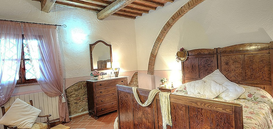 Elegant bed in Tuscan double bedroom