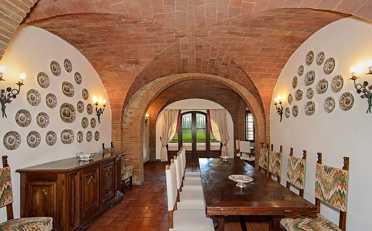 Large dining room with vaulted terracotta ceilings