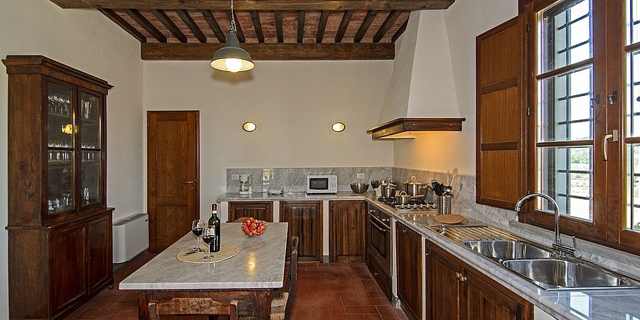 Kitchen with antique furniture in Tuscan villa