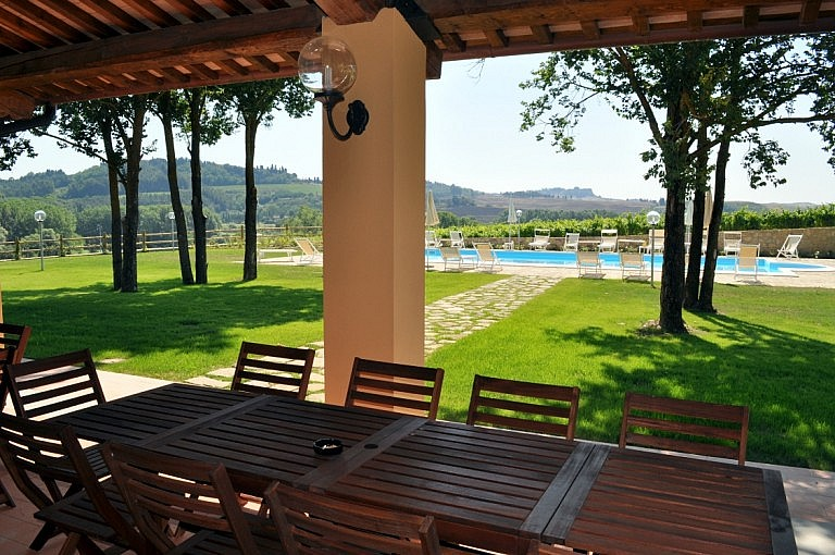 Pergola in front of the pool in villa surrounded by vineyards