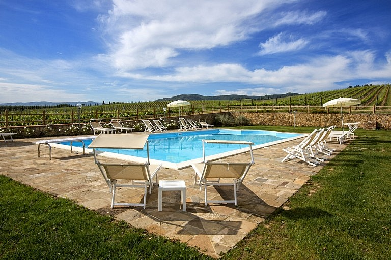 Swimming pool surrounded by Chianti vineyards