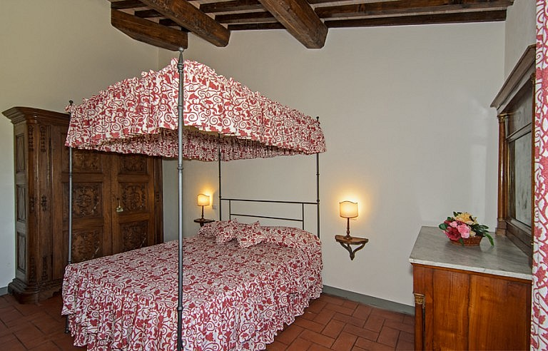 French bed in Tuscan bedroom