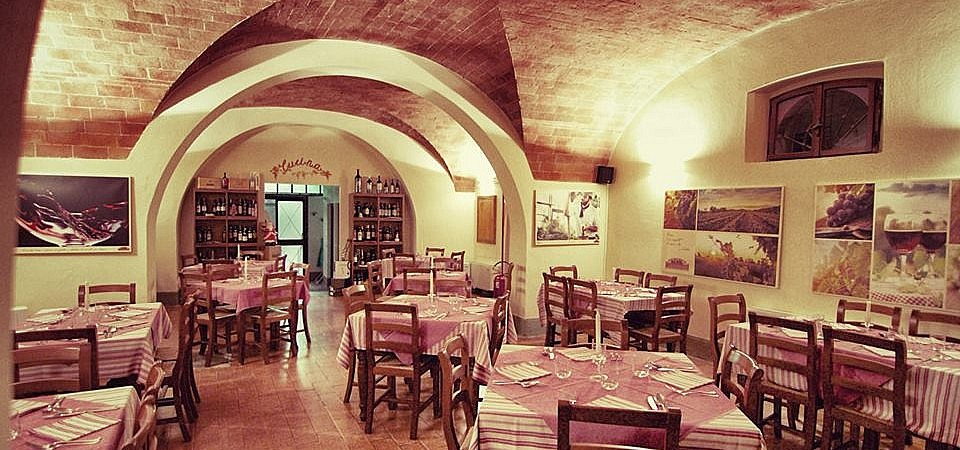 Beautiful vaulted dining room of a restaurant in Terricciola