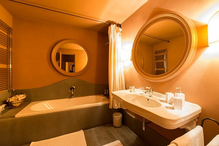 Bathroom with tub in luxury suites in Tuscan B&B