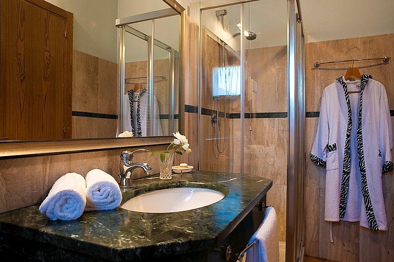 Marble tiled bathrooms in stylish country accommodation near Siena