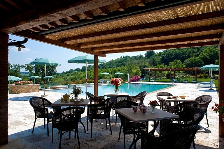 Veranda by the pool at a country residence near Colle Valdelsa