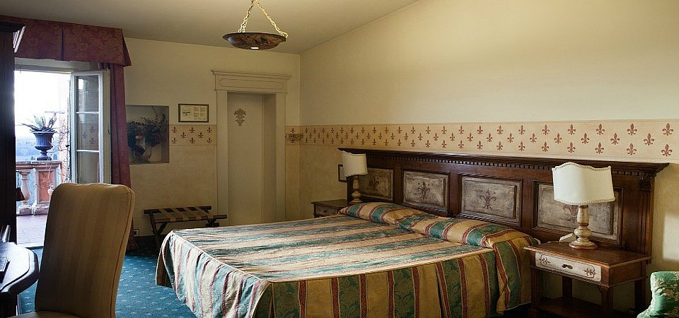 Classic bedrooms in small town hotel