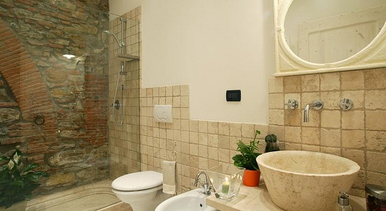 Large bathroom with travertino marble
