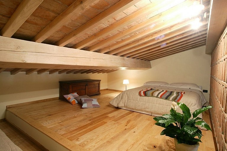 Relaxing bedroom in farmhouse loft