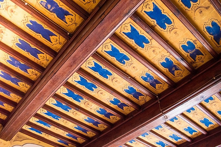 Decorated wooden ceiling in interiors of a resort
