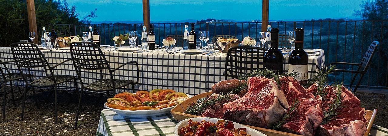 Alfresco dinner with fiorentina steak at Tuscan agriturismo