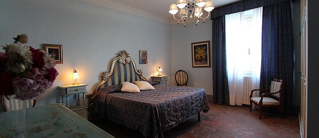 Elegant bedroom in Tuscan villa with view